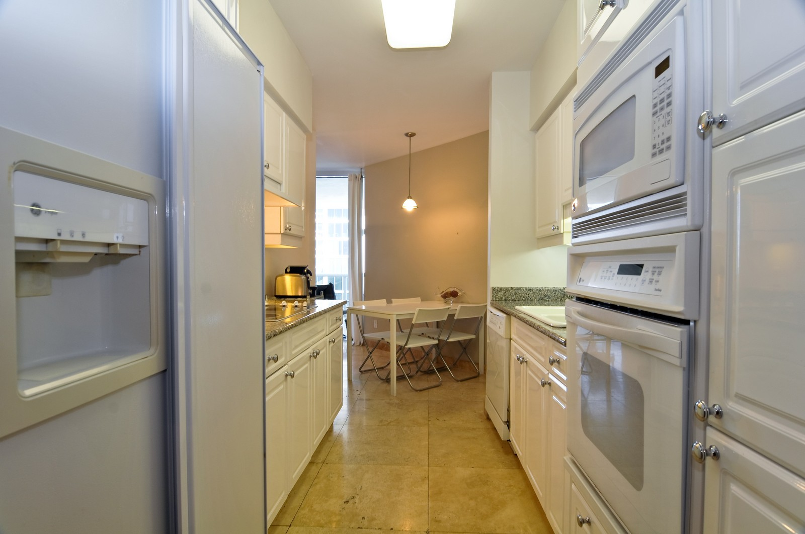 Real Estate Photography - 4775 Collins Ave, Unit 3708, Miami Beach, FL, 33140 - Kitchen / Breakfast Room