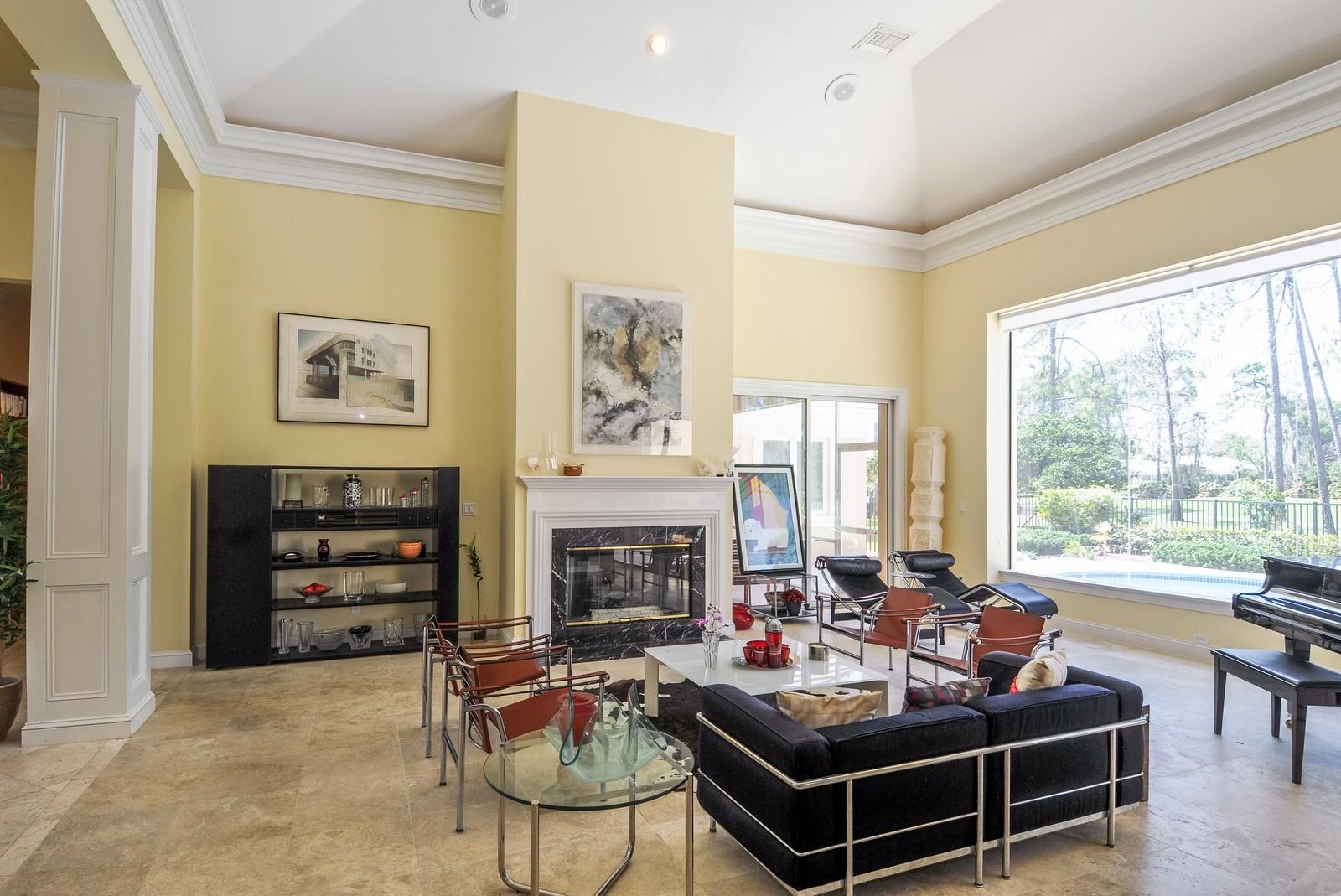 Real Estate Photography - 13501 Pond Apple Drive E, Naples, FL, 34119 - Living Room