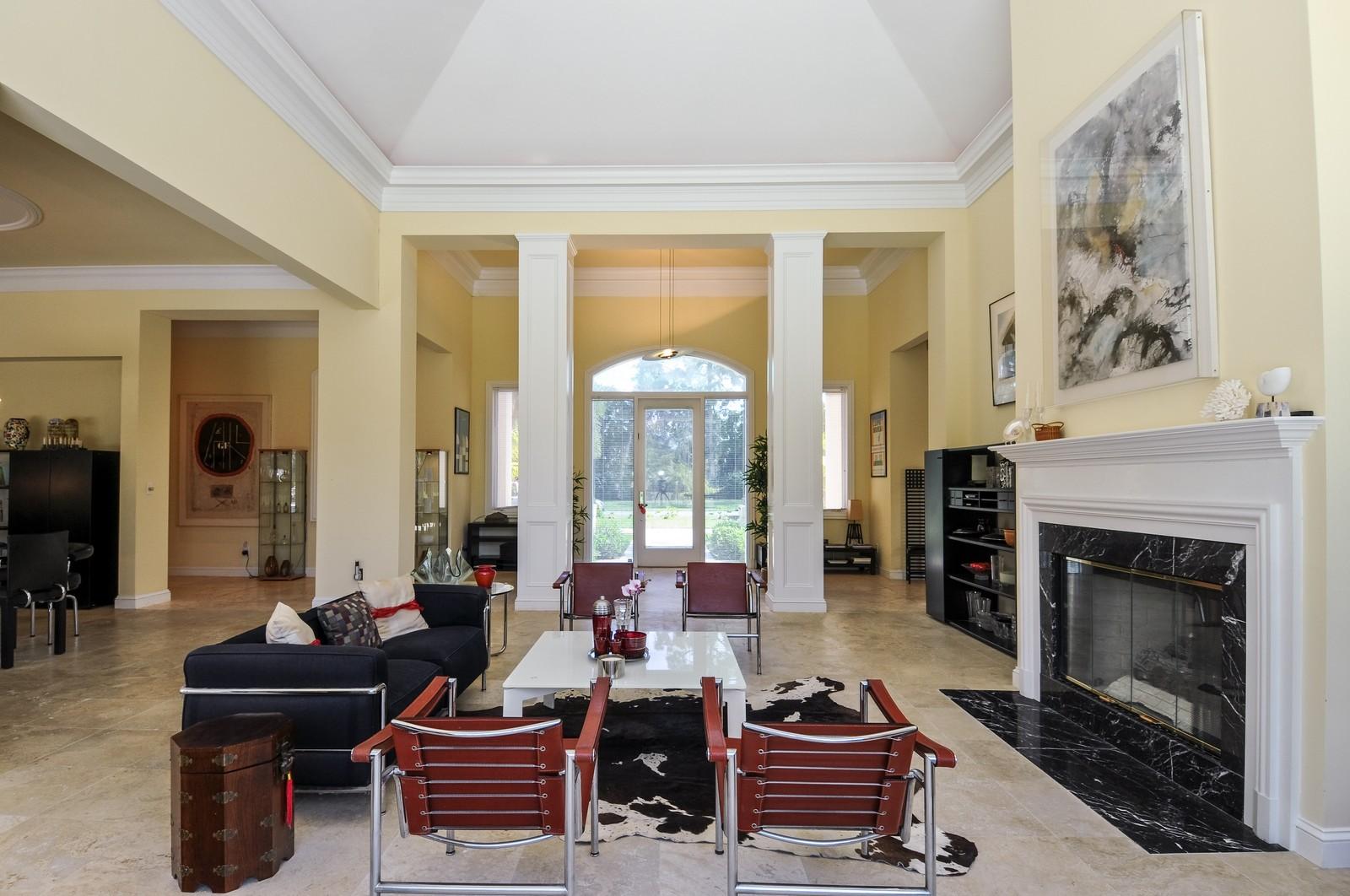 Real Estate Photography - 13501 Pond Apple Drive E, Naples, FL, 34119 - Foyer/Living Room