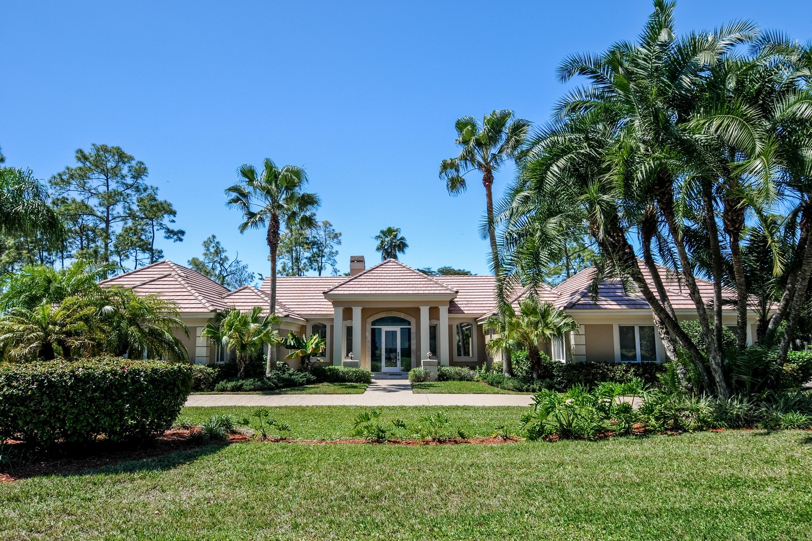Real Estate Photography - 13501 Pond Apple Drive E, Naples, FL, 34119 - Front View