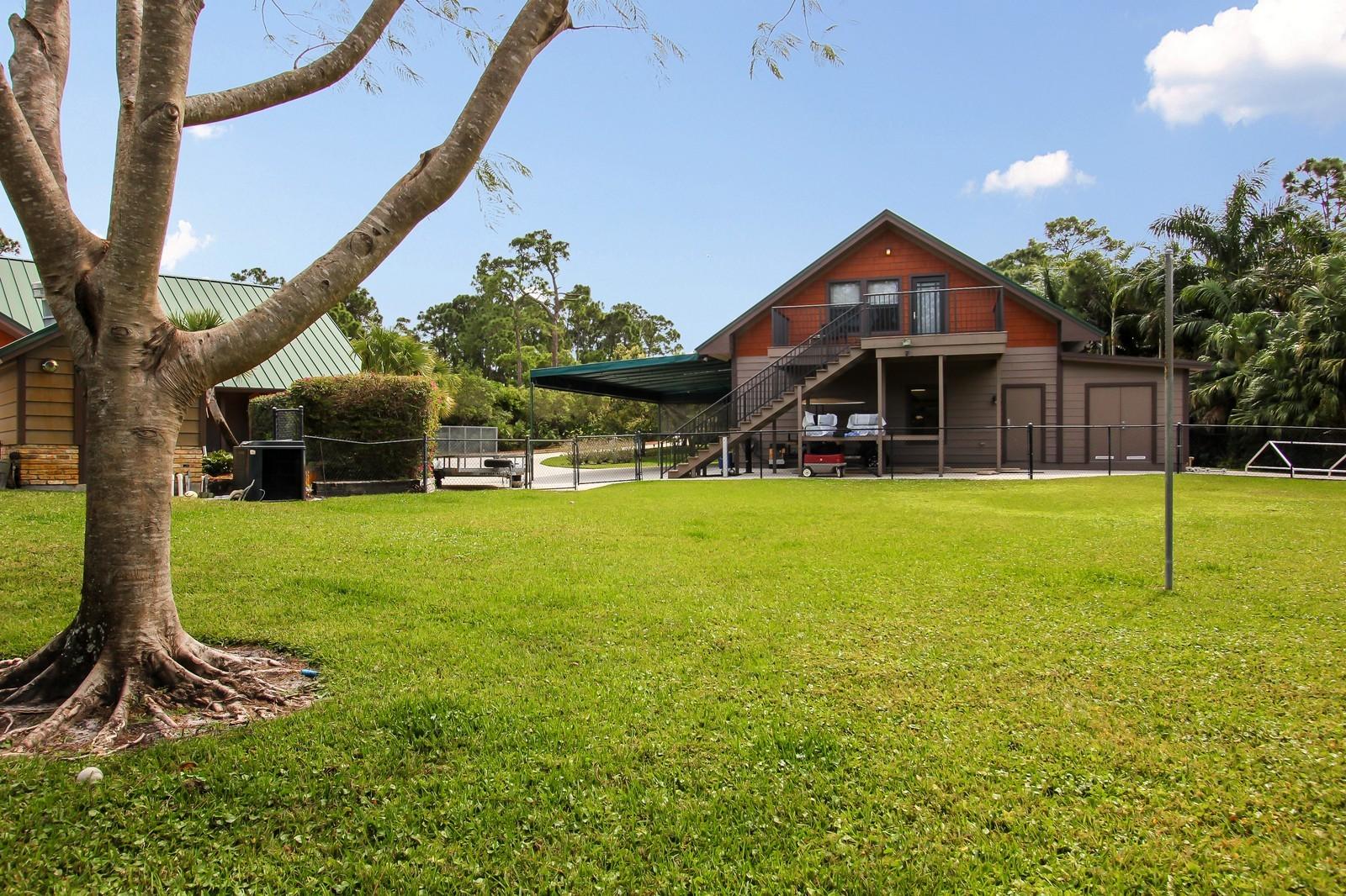 Real Estate Photography - 18300 SE Loxahatchee River Rd, Jupiter, FL, 33458 - Back Yard