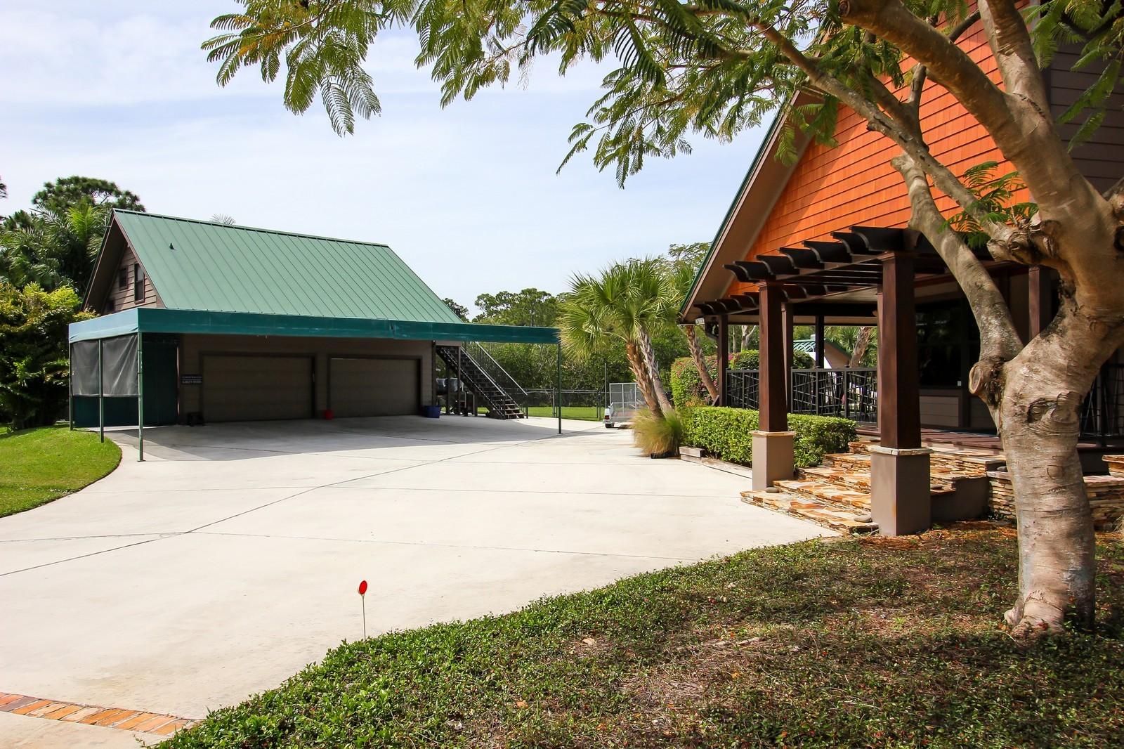 Real Estate Photography - 18300 SE Loxahatchee River Rd, Jupiter, FL, 33458 - Garage