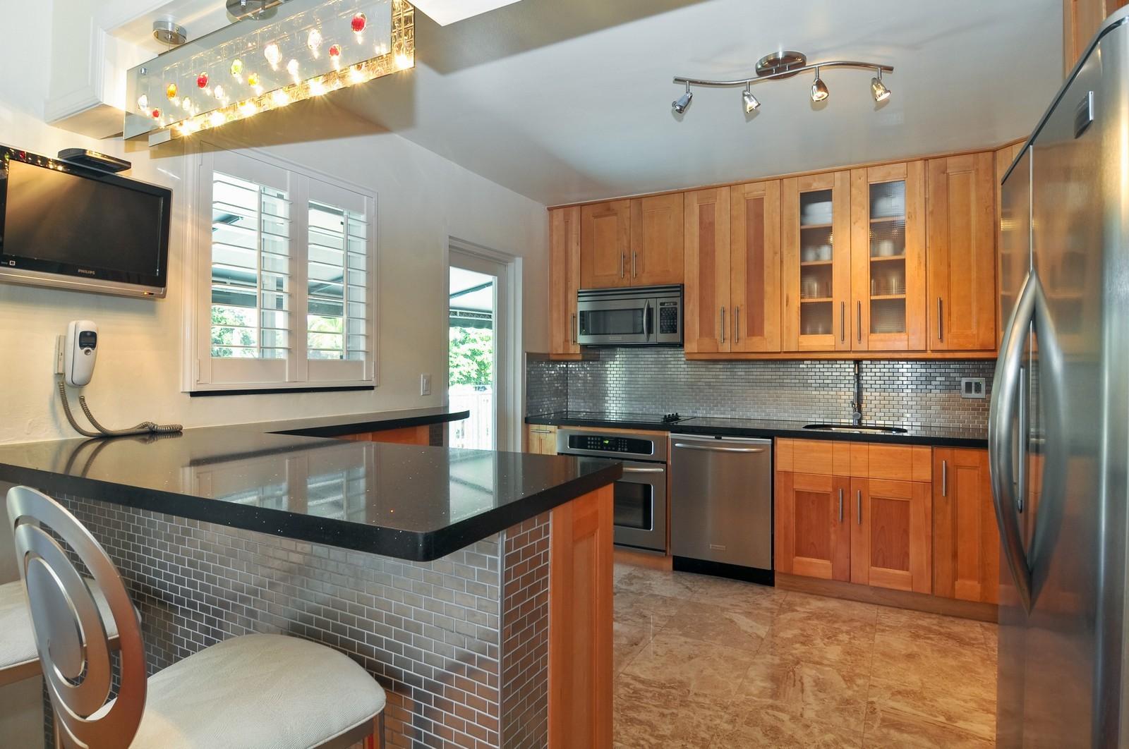Real Estate Photography - 2010 NE 121st Rd, Miami, FL, 33181 - Kitchen