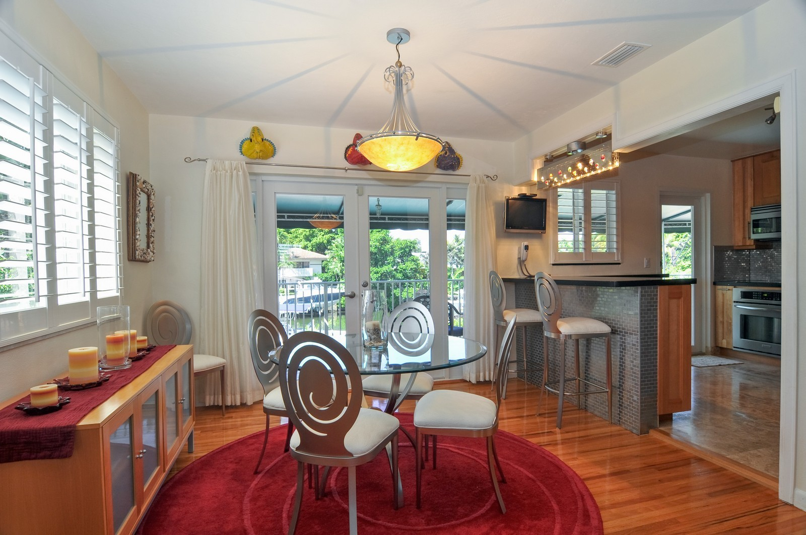 Real Estate Photography - 2010 NE 121st Rd, Miami, FL, 33181 - Kitchen / Dining Room
