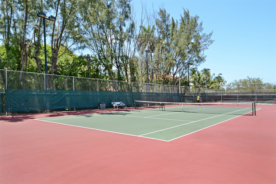 Real Estate Photography - 302 S Coconut Lane, Miami Beach, FL, 33139 - Palm Island Tennis Court's
