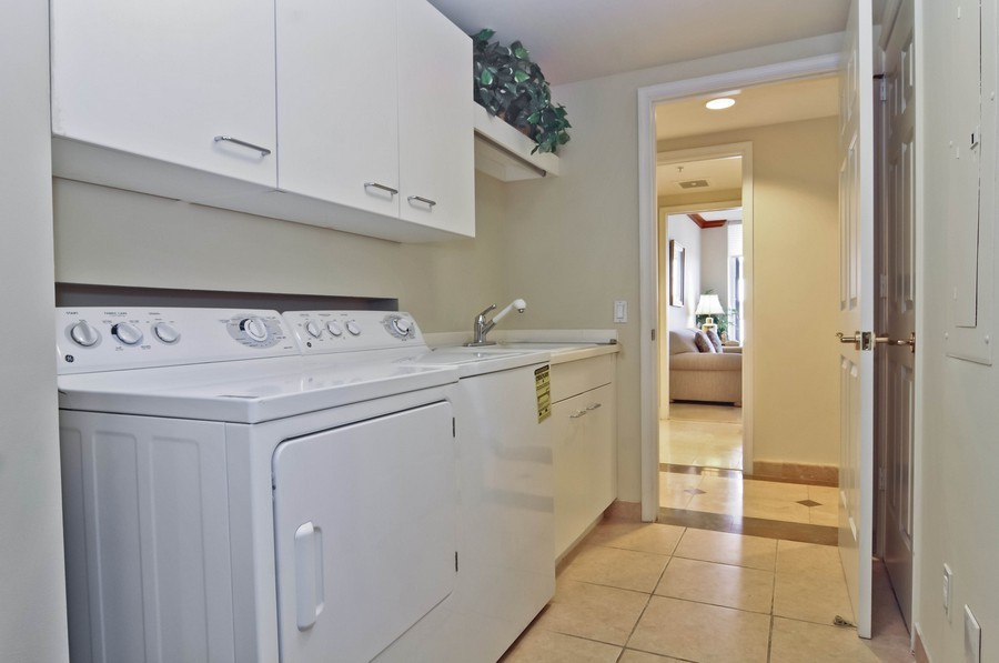 Real Estate Photography - 13627 Dearing Bay Dr, Unit 701, Coral Gables, FL, 33158 - Laundry Room