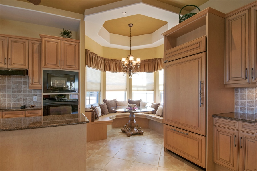 Real Estate Photography - 510 Avellino Isles Cir, Unit 2302, Naples, FL, 34119 - Kitchen / Breakfast Room
