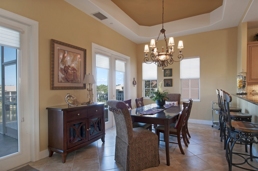 Real Estate Photography - 510 Avellino Isles Cir, Unit 2302, Naples, FL, 34119 - Dining Room