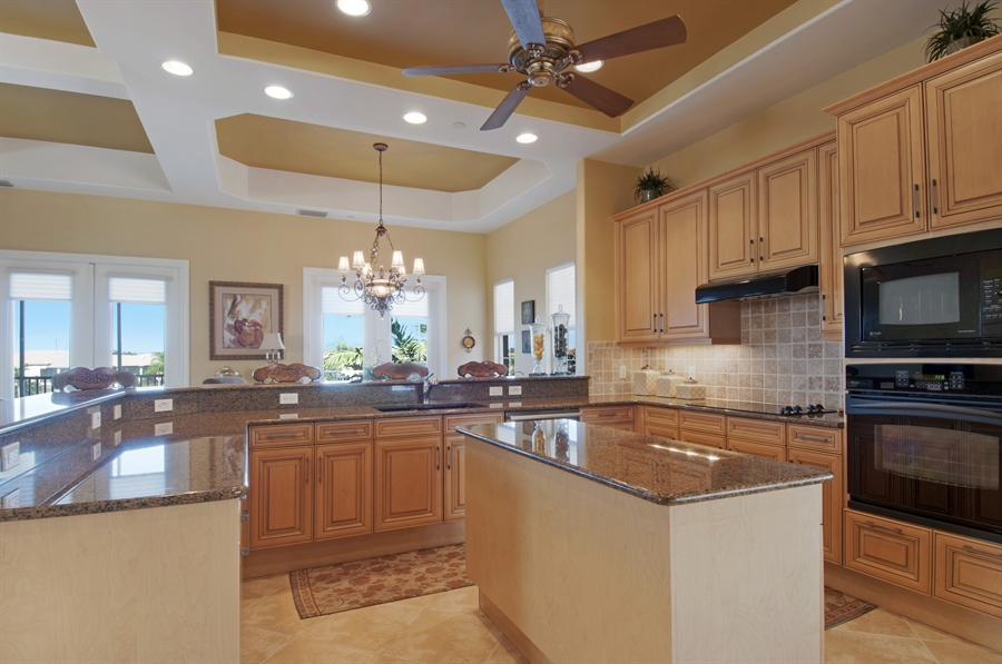 Real Estate Photography - 510 Avellino Isles Cir, Unit 2302, Naples, FL, 34119 - Kitchen