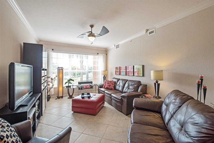 Real Estate Photography - 7065 Sierra Club Cir, Unit 206, Naples, FL, 34113 - Living Room