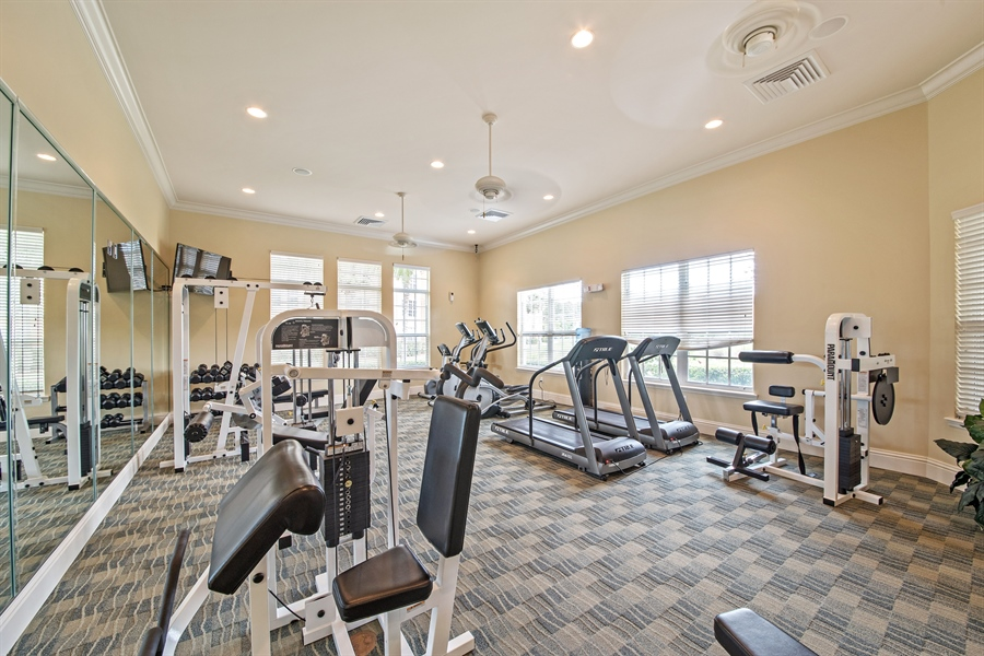 Real Estate Photography - 7065 Sierra Club Cir, Unit 206, Naples, FL, 34113 - Fitness Room