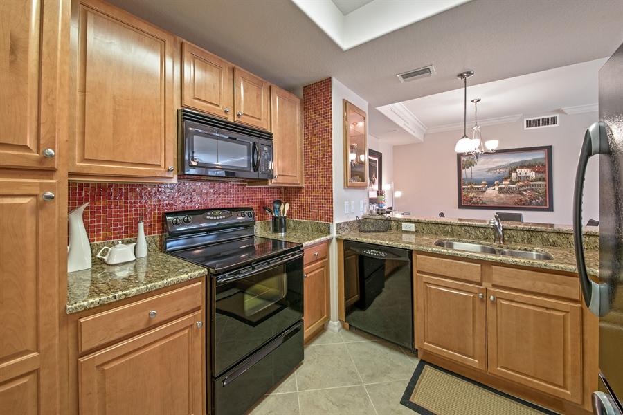 Real Estate Photography - 7065 Sierra Club Cir, Unit 206, Naples, FL, 34113 - Kitchen