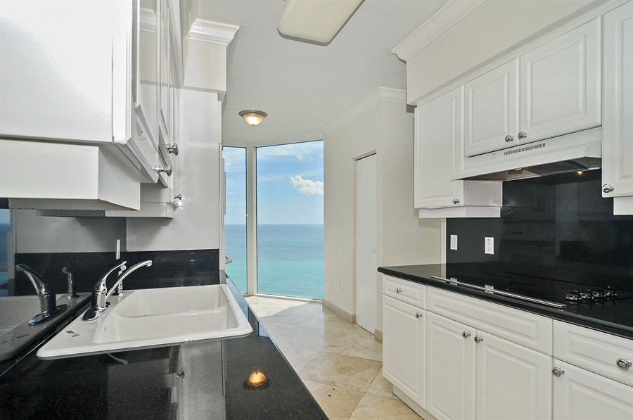 Real Estate Photography - 4775 Collins Ave, Unit 3103, Miami, FL, 33140 - Kitchen / Breakfast Room