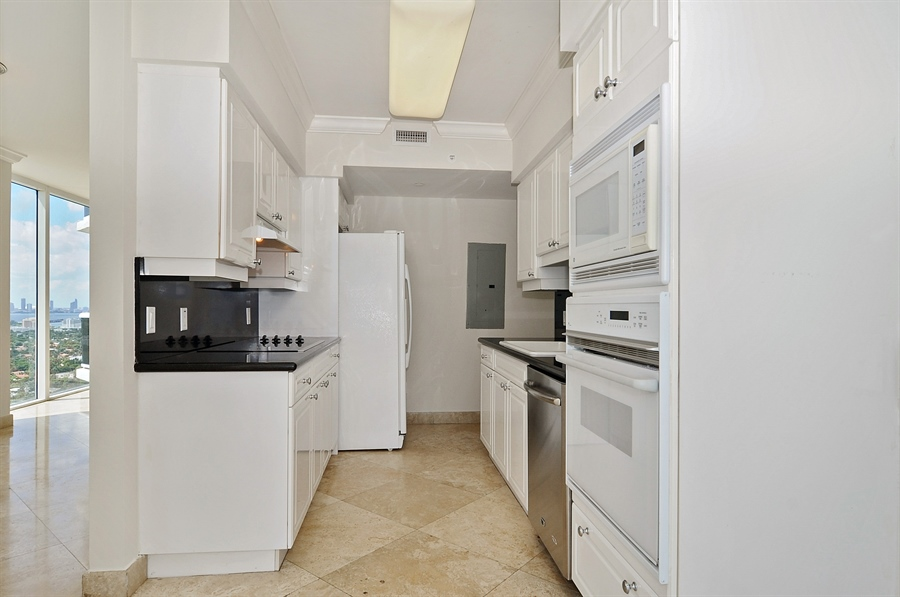 Real Estate Photography - 4775 Collins Ave, Unit 3103, Miami, FL, 33140 - Kitchen