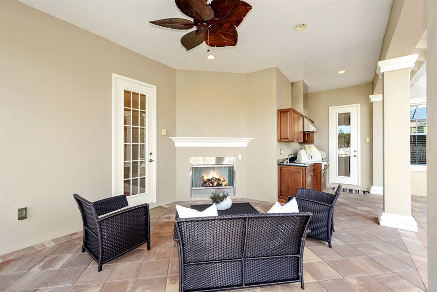 Real Estate Photography - 615 Balibay Rd, Apollo Beach, FL, 33572 - Outside Lanai with Gas Fireplace