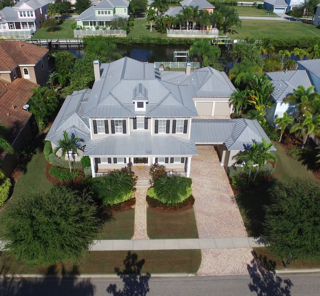 Real Estate Photography - 615 Balibay Rd, Apollo Beach, FL, 33572 - Front Aerial View / Canal with direct bay access