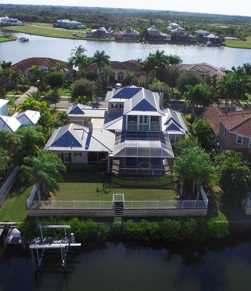 Real Estate Photography - 615 Balibay Rd, Apollo Beach, FL, 33572 - Rear Aerial Views of Canal and Lagoon