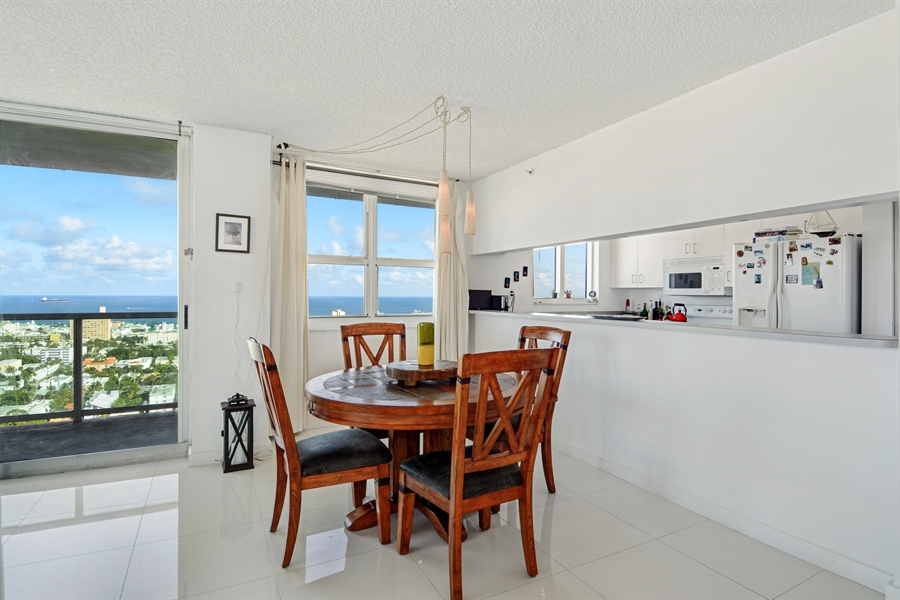 Real Estate Photography - 650 West Ave, Apt 2812, Miami Beach, FL, 33139 - Dining Room