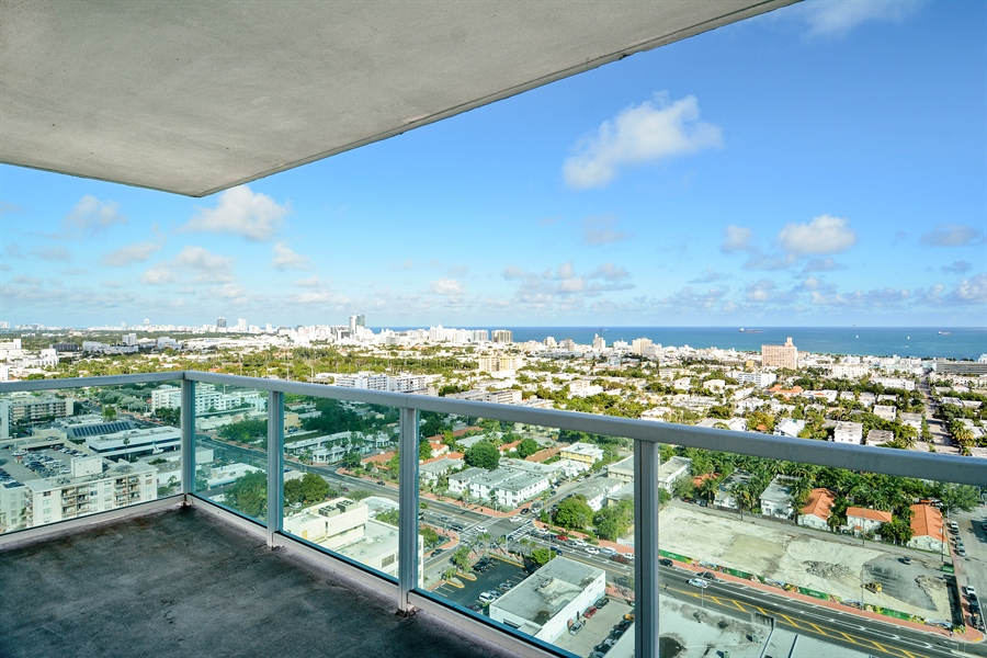 Real Estate Photography - 650 West Ave, Apt 2812, Miami Beach, FL, 33139 - East Balcony