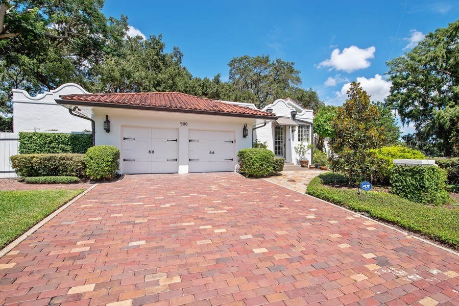 Real Estate Photography - 900 S. Lake Adair Blvd., ORLANDO, FL, 32804 - Side View with Side Entrance and Open Porch with L