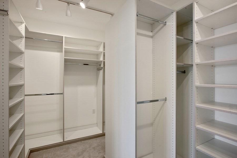 Real Estate Photography - 2 Grove Isle Dr, Unit B410, Coconut Grove, FL, 33133 - Master Bedroom Closet