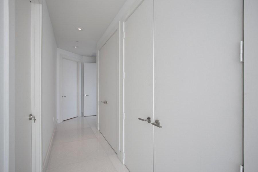 Real Estate Photography - 4100 Island Blvd. #2001, Aventura, FL, 33160 - Master Bedroom Hallway