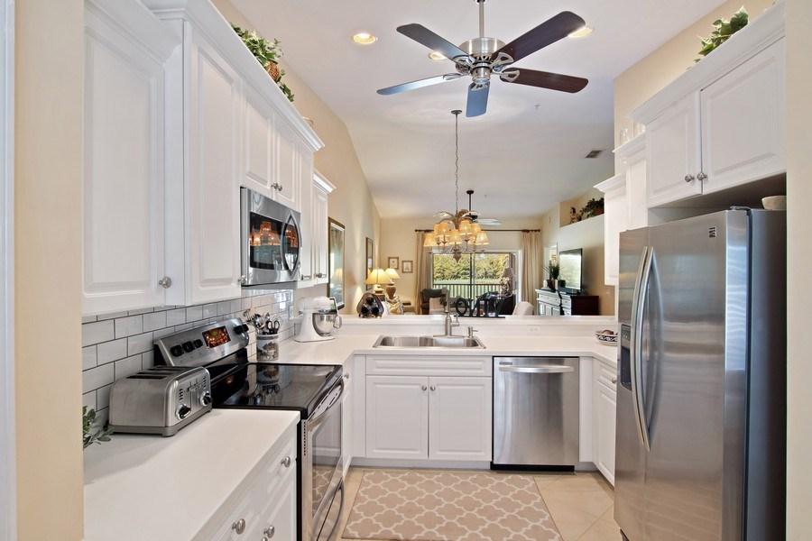 Real Estate Photography - 3860 Sawgrass Way, 2625, Naples, FL, 34112 - Kitchen
