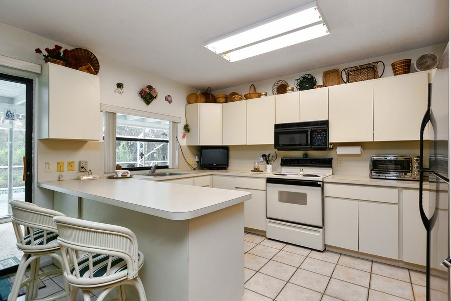 Real Estate Photography - 13800 SW 78th Pl, Miami, FL, 33158 - Kitchen