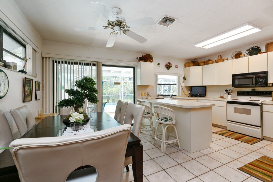 Real Estate Photography - 13800 SW 78th Pl, Miami, FL, 33158 - Kitchen / Dining Room