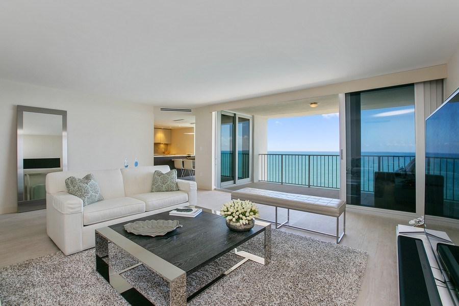 Real Estate Photography - 881 Ocean Dr, Penthouse 27E, Key Biscayne, FL, 33149 - LIVING ROOM TOWARDS BALCONY
