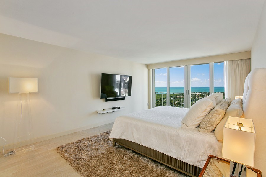 Real Estate Photography - 881 Ocean Dr, Penthouse 27E, Key Biscayne, FL, 33149 - SPACIOUS MASTER BEDROOM WITH BISCAYNE BAY VIEWS