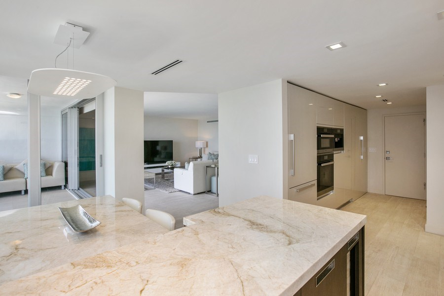 Real Estate Photography - 881 Ocean Dr, Penthouse 27E, Key Biscayne, FL, 33149 - LOOKING FROM KITCHEN TOWARDS BALCONY AND LIVING RO