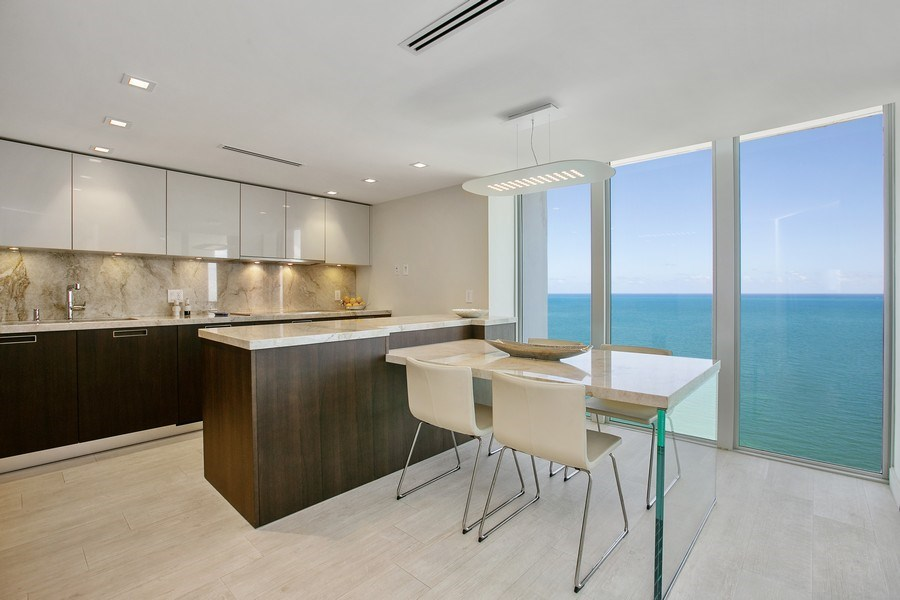 Real Estate Photography - 881 Ocean Dr, Penthouse 27E, Key Biscayne, FL, 33149 - OCEAN VIEWS FROM DINING AREA