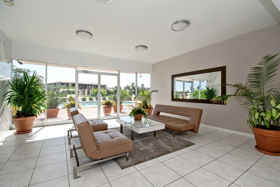 Real Estate Photography - 401 Golden Isles Dr., Apt. 1110, Hallandale, FL, 33009 - Lobby