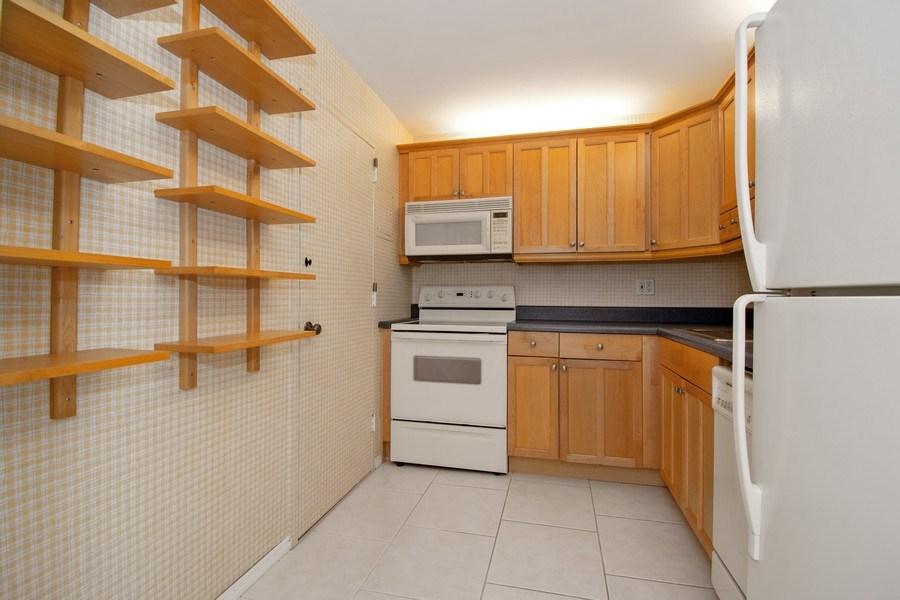 Real Estate Photography - 401 Golden Isles Dr., Apt. 1110, Hallandale, FL, 33009 - Kitchen