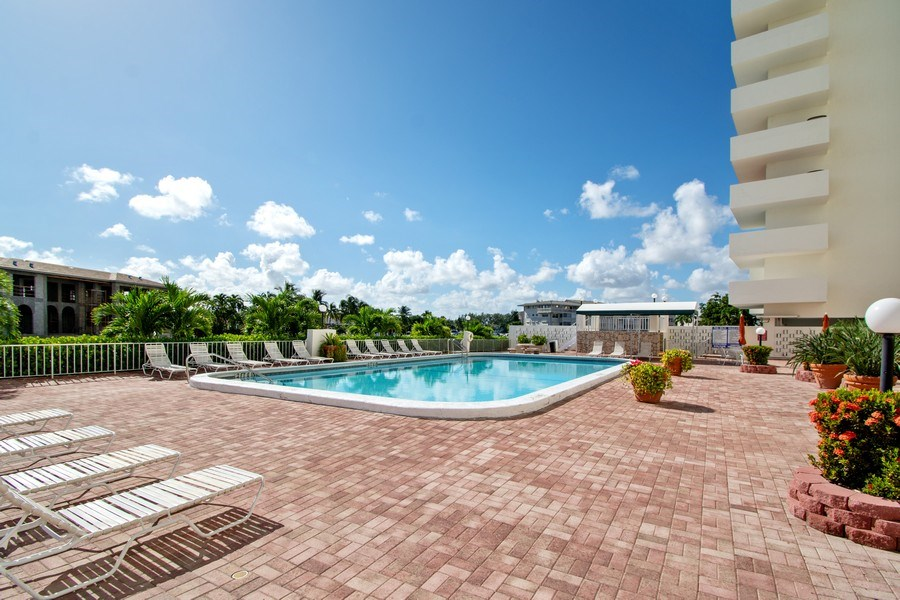 Real Estate Photography - 401 Golden Isles Dr., Apt. 1110, Hallandale, FL, 33009 - Pool