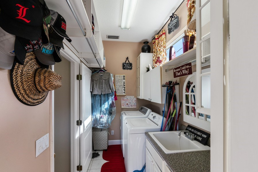 Real Estate Photography - 10445 Canary Isle Dr, Tampa, FL, 33647 - Laundry Room