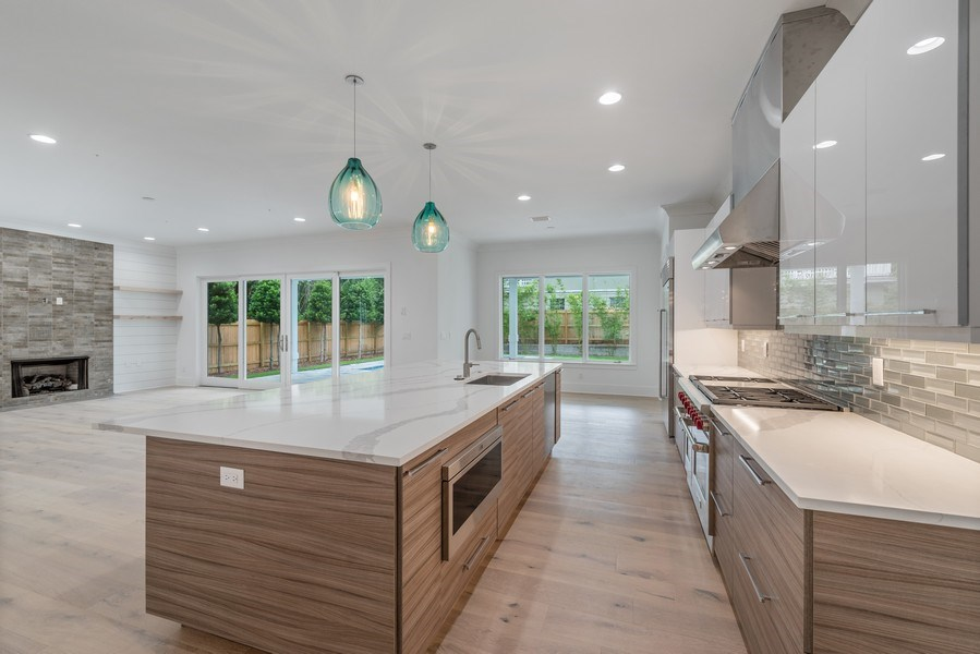 Real Estate Photography - 1560 Bryan Ave, Winter Park, FL, 32789 - Kitchen & Family Room