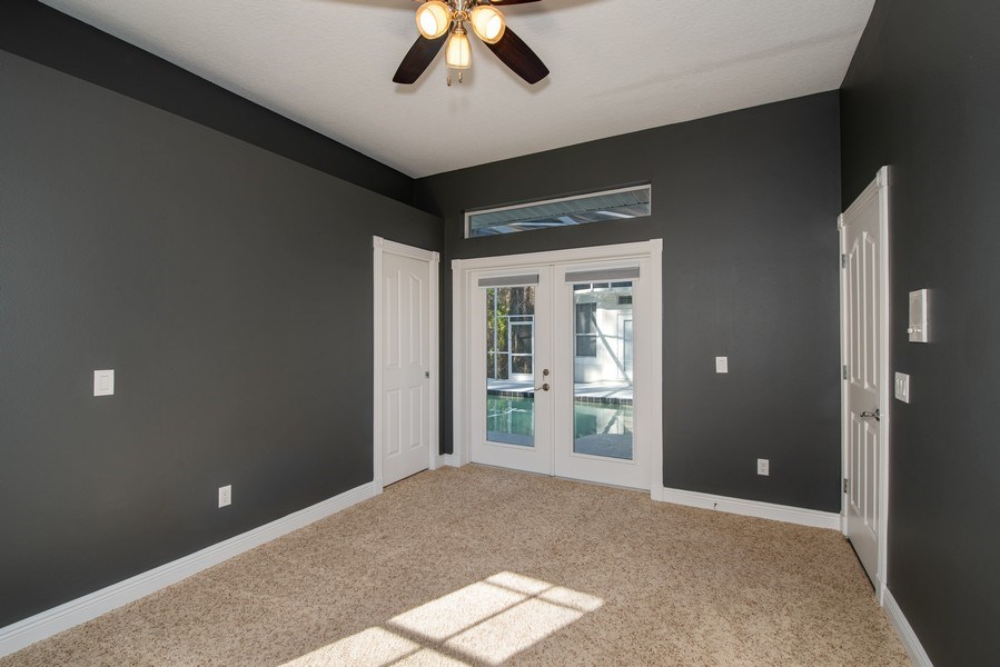 Real Estate Photography - 297 LESLIE LANE, LAKE MARY, FL, 32746 - BEDROOM FOUR WITH FRENCH DOORS AND BATHROOM THREE