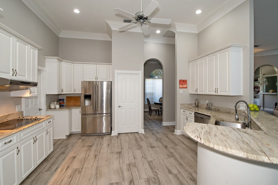 Real Estate Photography - 297 LESLIE LANE, LAKE MARY, FL, 32746 - KITCHEN WITH GRANITE AND STAINLESS STEEL APPLIANCE