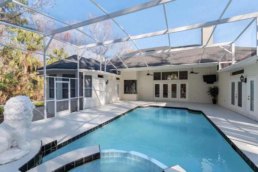Real Estate Photography - 297 LESLIE LANE, LAKE MARY, FL, 32746 - SCREENED POOL, SPA AND LANAI