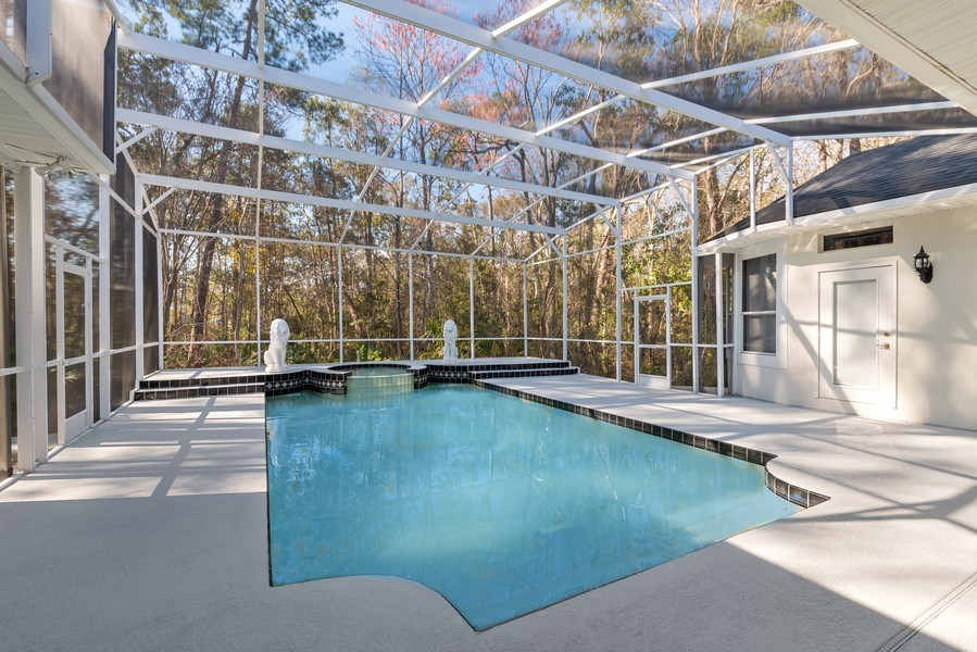Real Estate Photography - 297 LESLIE LANE, LAKE MARY, FL, 32746 - SCREENED POOL AND SPA OVERLOOKING NATURAL CONSERVA