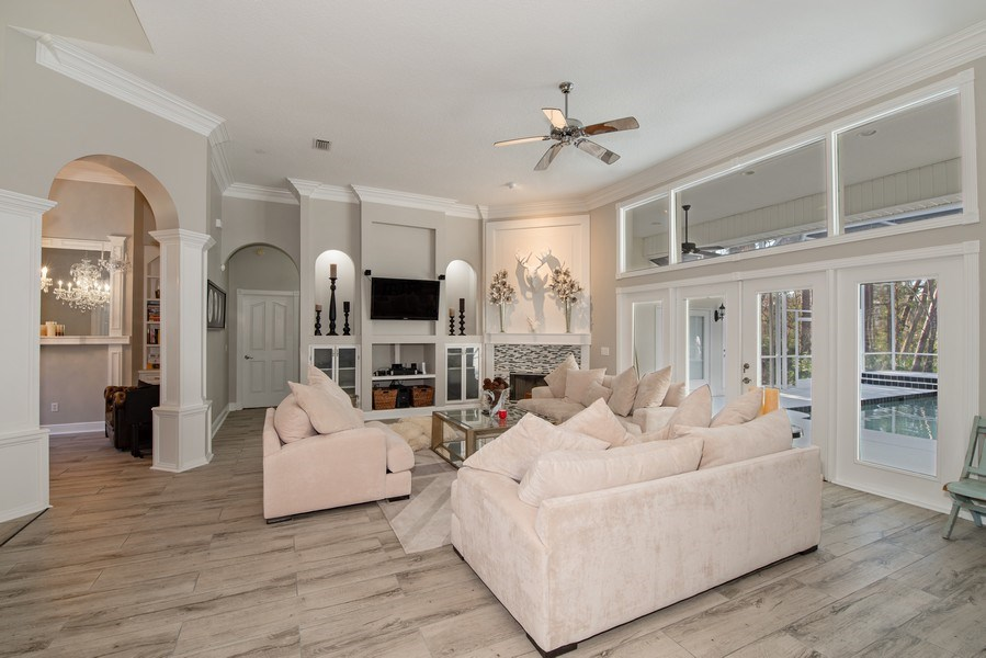 Real Estate Photography - 297 LESLIE LANE, LAKE MARY, FL, 32746 - FAMILY ROOM WITH FIREPLACE AND BUILT-IN FEATURES
