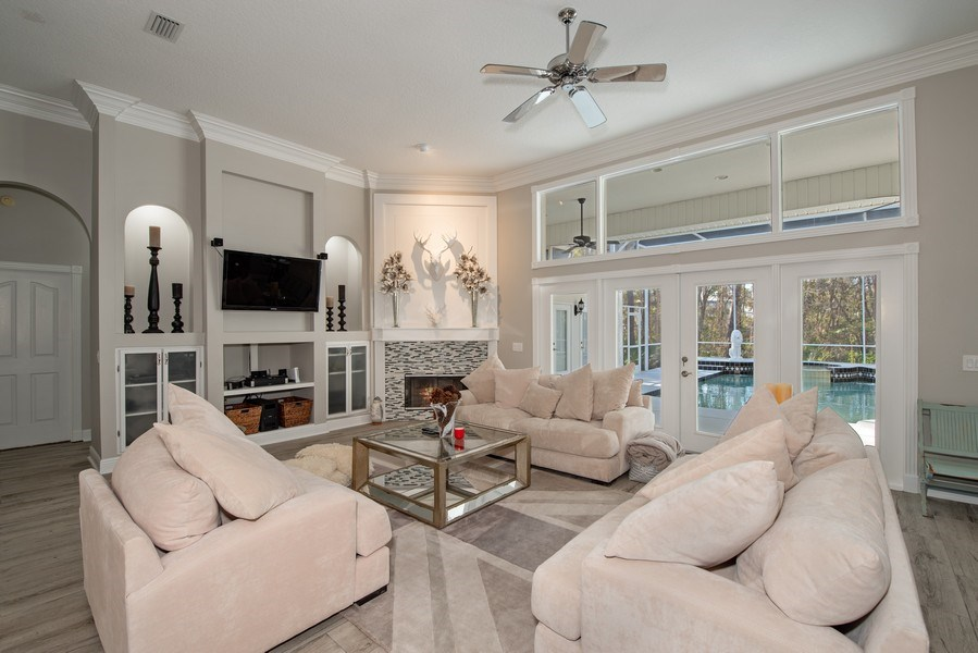 Real Estate Photography - 297 LESLIE LANE, LAKE MARY, FL, 32746 - FAMILY ROOM OVERLOOKING POOL