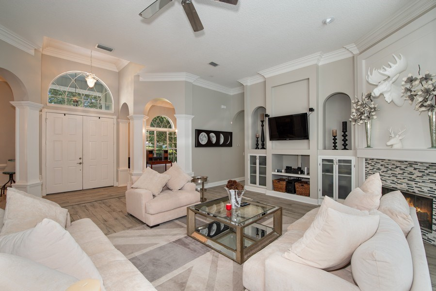 Real Estate Photography - 297 LESLIE LANE, LAKE MARY, FL, 32746 - FAMILY ROOM AND FOYER VIEWS