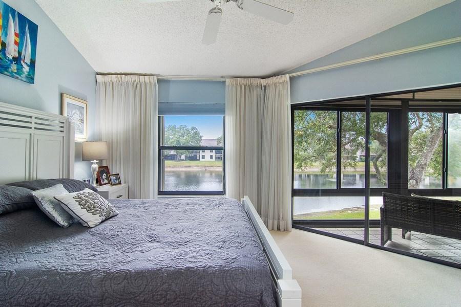 Real Estate Photography - 6080 SE Martinique Dr, Apt 202, Stuart, FL, 34997 - Master Bedroom