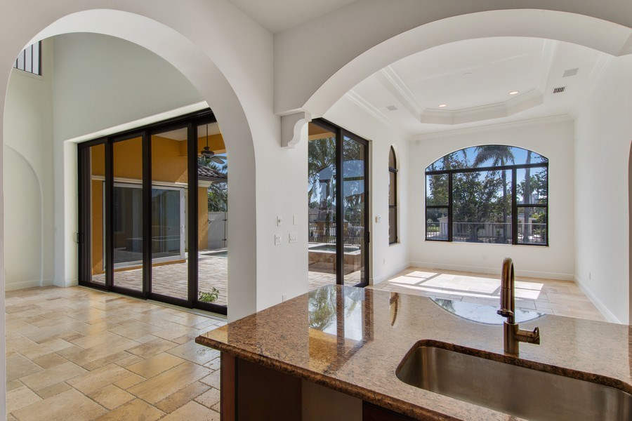 Real Estate Photography - 494 Segal Ave, Naples, FL, 34108 - Kitchen / Dining Room