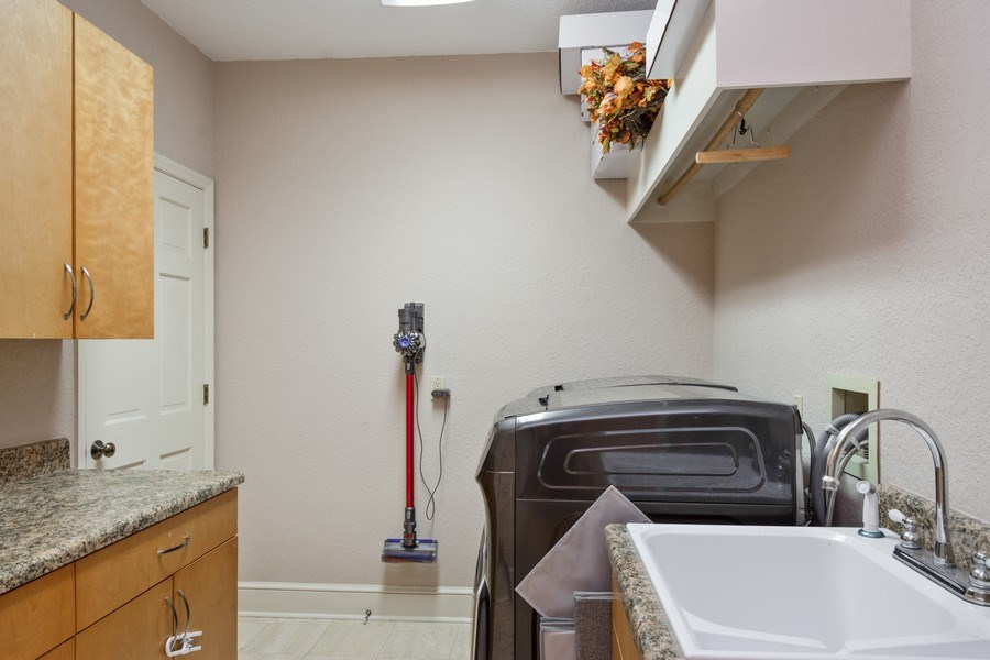 Real Estate Photography - 6513 Stonington South, Tampa, FL, 33647 - Laundry Room