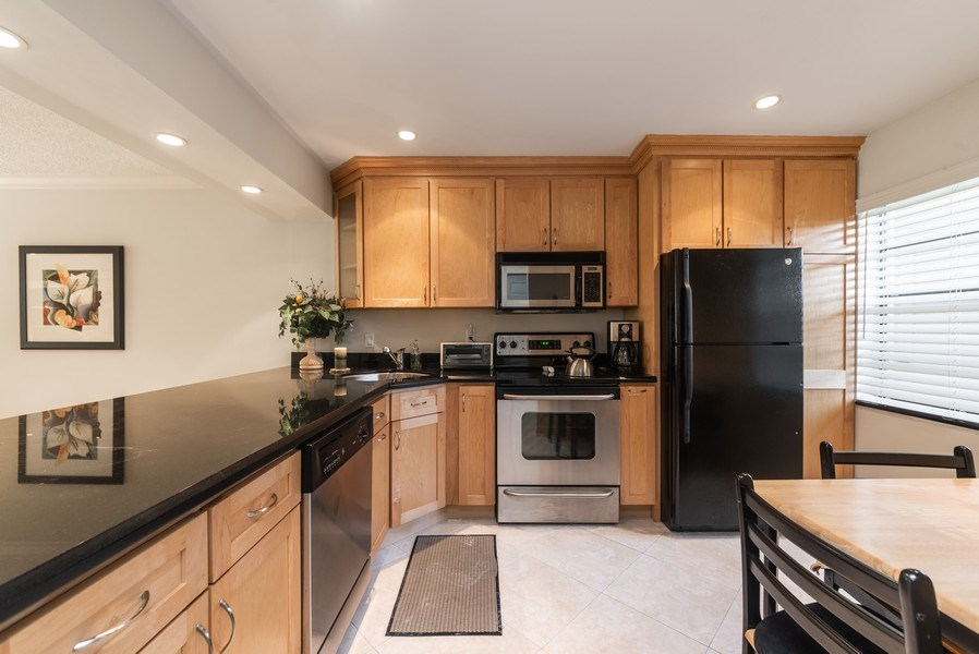 Real Estate Photography - 9284 Vista Del Lago, Unit C, Boca Raton, FL, 33428 - Kitchen / Breakfast Room