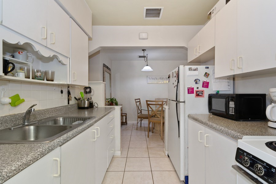 Real Estate Photography - 1324 NE 16 Terrace, Fort Lauderdale, FL, 33304 - Rental Apartment Kitchen & Dining